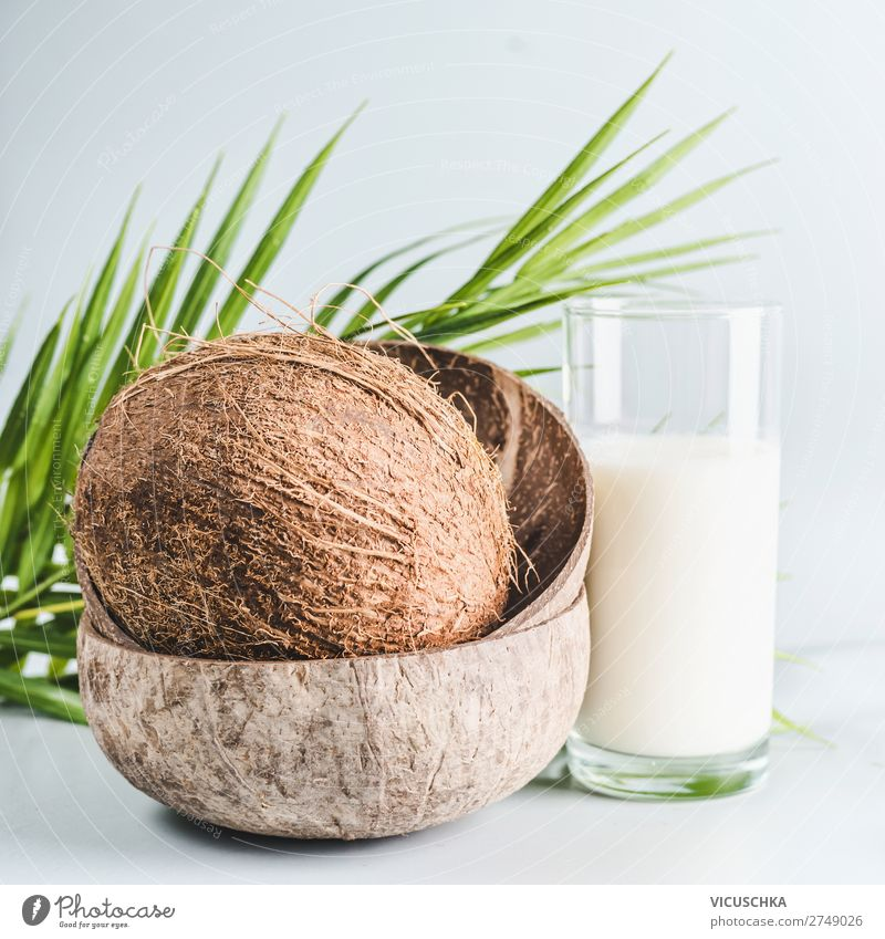 Coconut milk in glass with whole coconut Food Dairy Products Nutrition Organic produce Vegetarian diet Diet Beverage Glass Summer Design Healthy Protein