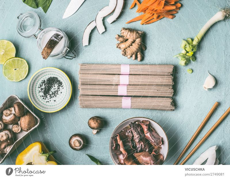 Asian noodles and ingredients on the kitchen table Food Nutrition Vegetarian diet Diet Asian Food Crockery Bowl Shopping Style Design Healthy Eating Table