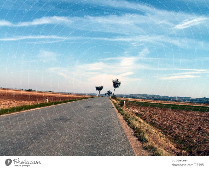 almost forward Country road Field Horizon Clouds Speed Street Sky Blue Movement