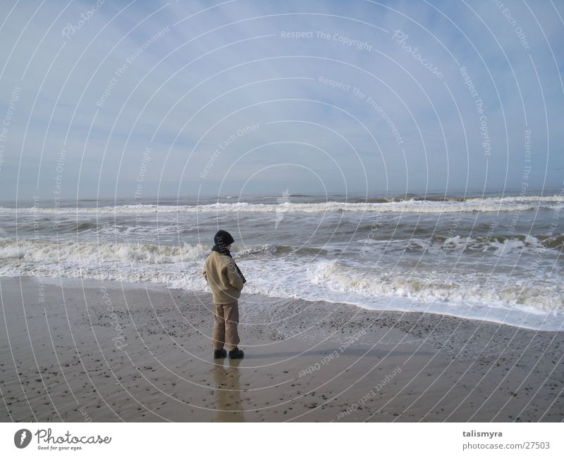 Spring at the North Sea Child warmly wrapped up on the beach Water Sand Sky
