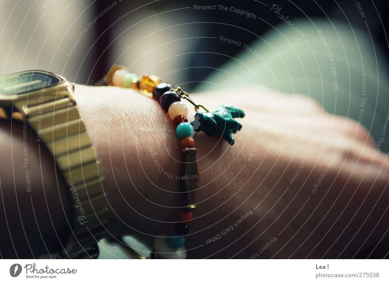Hottehü Feminine Hand 1 Human being Accessory Jewellery Wristwatch Bracelet Sit Multicoloured Gold Turquoise Loneliness Relaxation Colour photo Interior shot