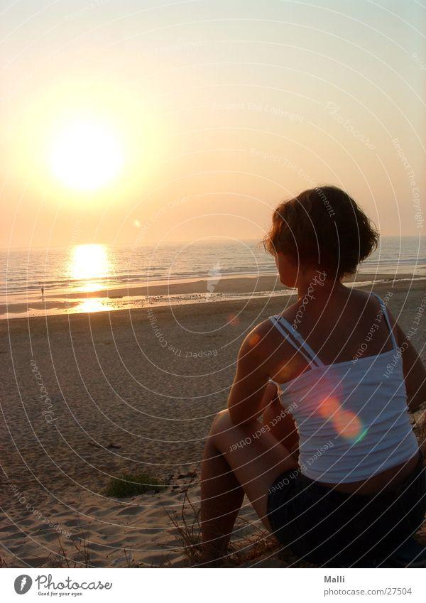 Evening at the Atlantic Ocean Beach Woman Sunset