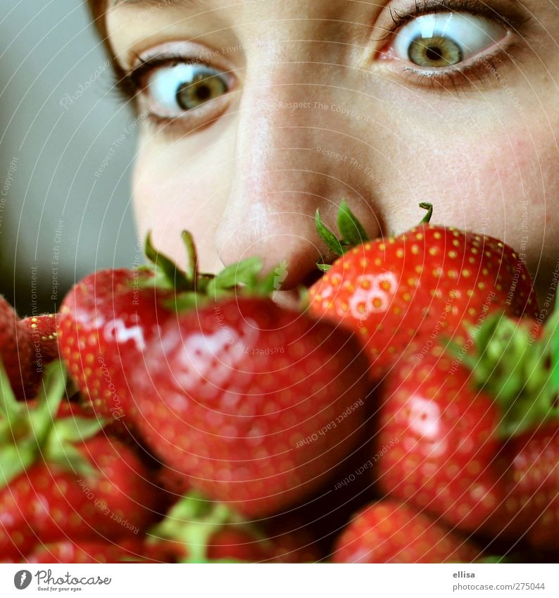 strawberry beard Fruit Eating Healthy Eating Feminine Young woman Youth (Young adults) Eyes Nose To feed Curiosity Strawberry Strawberry variety Green Red Odor