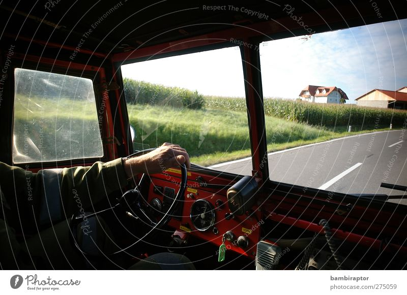 on the road Man Adults Arm Hand 1 Human being Means of transport Motoring Street Vehicle Vintage car Driving Fire department Deployment Dashboard Steering wheel