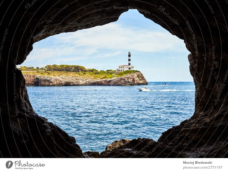 Portocolom Lighthouse seen from a cave, Mallorca. Vacation & Travel Tourism Trip Adventure Far-off places Freedom Sightseeing Cruise Expedition Summer