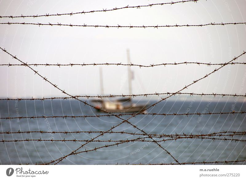 Behind the curtain Vacation & Travel Trip Far-off places Ocean Nature Water Horizon Navigation Sailboat Moody Captured Penitentiary Dinghy Barbed wire