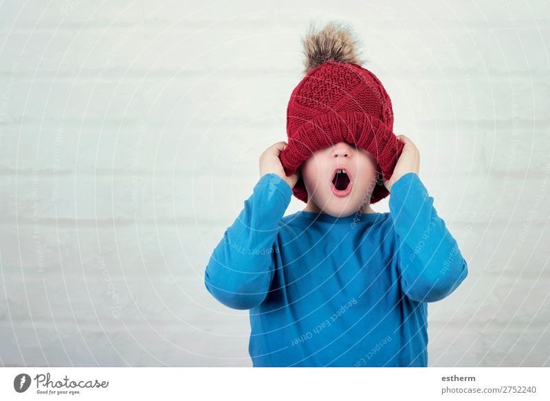 funny child with winter hat on brick background Lifestyle Joy Vacation & Travel Winter Snow Human being Masculine Child Toddler Infancy 1 8 - 13 years Weather