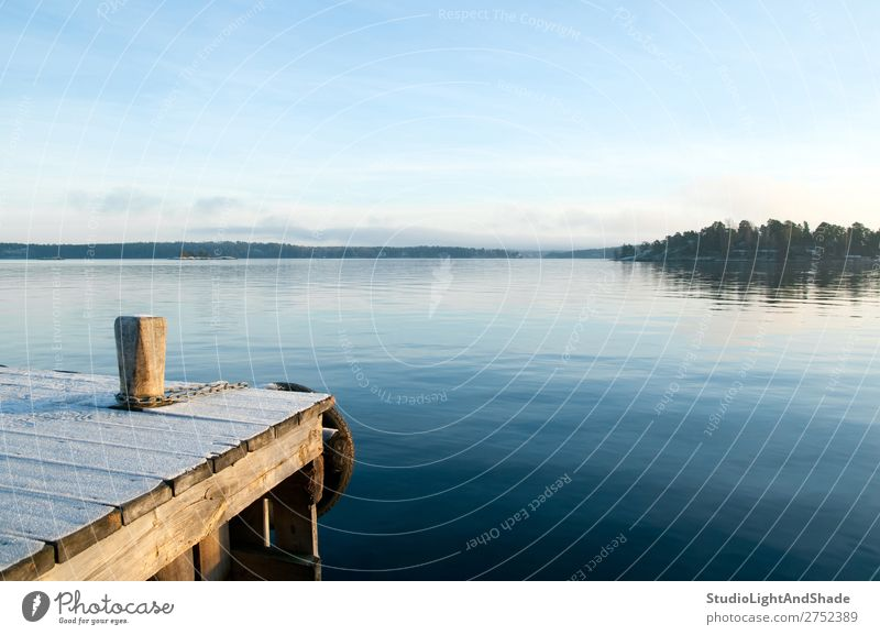 View over a calm lake Beautiful Relaxation Calm Island Winter Nature Landscape Sky Coast Lake Wood Natural Blue Serene jetty quayside water lakeshore Sunset