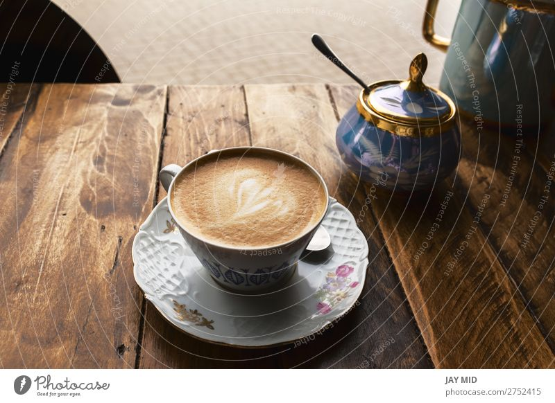 Cappuccino coffee in vintage porcelain cup on the wooden table Breakfast Beverage Coffee Espresso Shopping Table Restaurant Flower Wood Fresh Hot Brown Colour