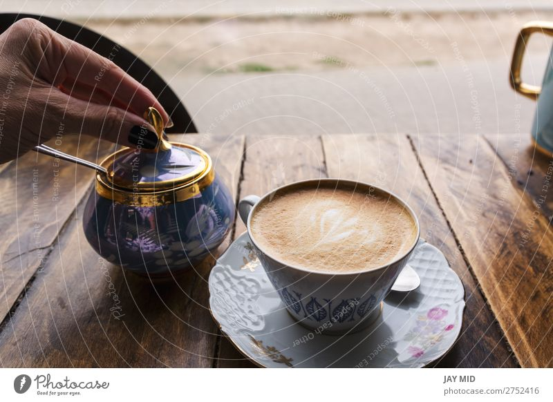 Cappuccino coffee in vintage porcelain cup on the wooden table Human being Vacation & Travel Colour Hand Flower Food Lifestyle Wood Feminine Brown Fresh