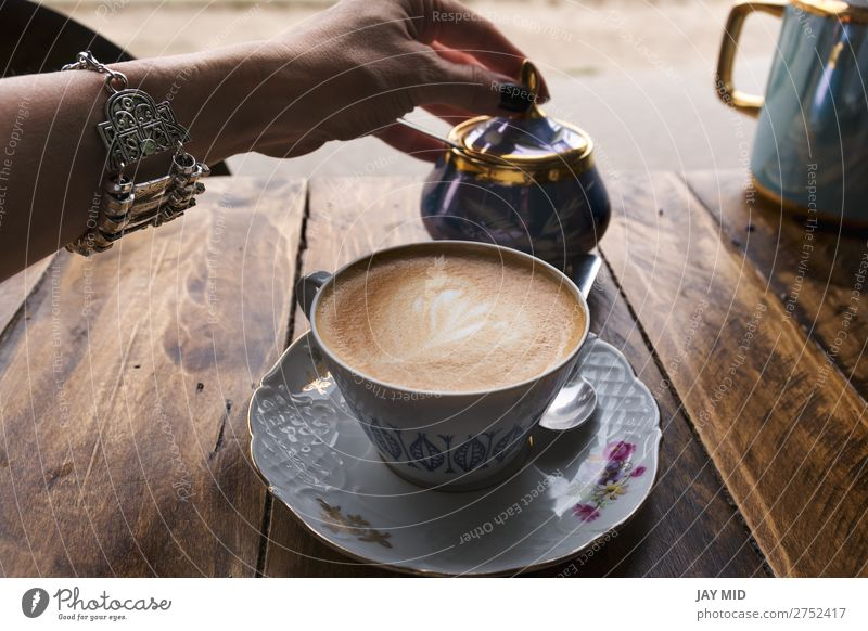 Cappuccino coffee in vintage porcelain cup Woman Human being Colour Hand Flower Relaxation Calm Food Lifestyle Adults Wood Feminine Brown Body Fresh