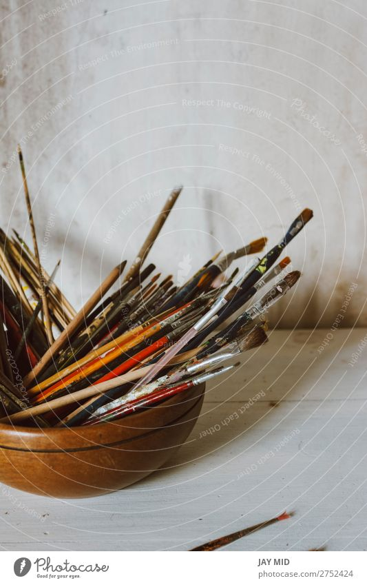 A collection of Artist's brushes. Art Culture Abstract Concept. Bowl Leisure and hobbies Craft (trade) Tool Painting and drawing (object) Wood Dirty White