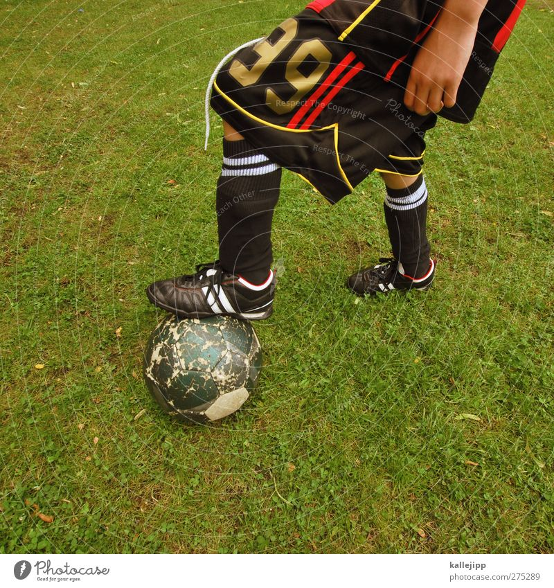 Human being Green Hand Sports Boy (child) Playing Leisure and hobbies Lifestyle Soccer Fitness Foot ball Digits and numbers Ball Sports Training Stockings