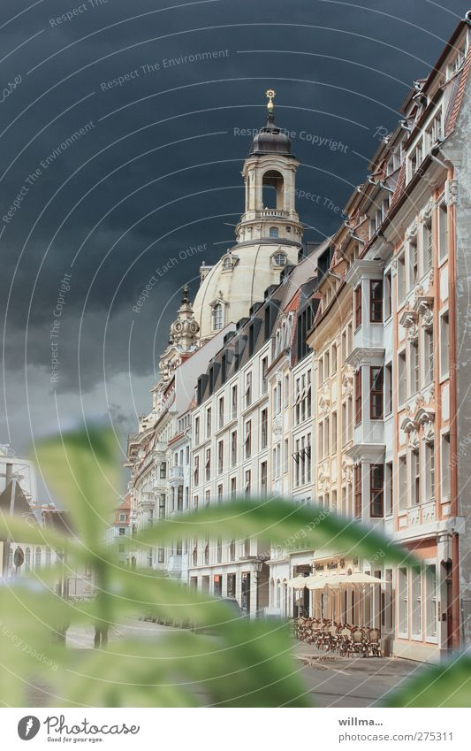 Alley with abandoned street café and view of the Frauenkirche Dresden Old town Historic built Tourist Attraction Sidewalk café Dark clouds Colour photo