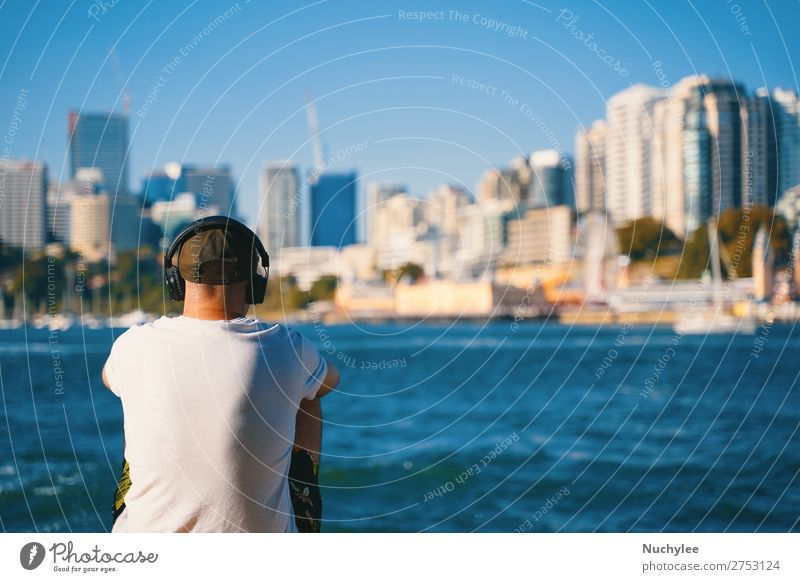 A man sitting at the beach and listening music Lifestyle Style Happy Relaxation Vacation & Travel Summer Beach Ocean Music Human being Man Adults Nature