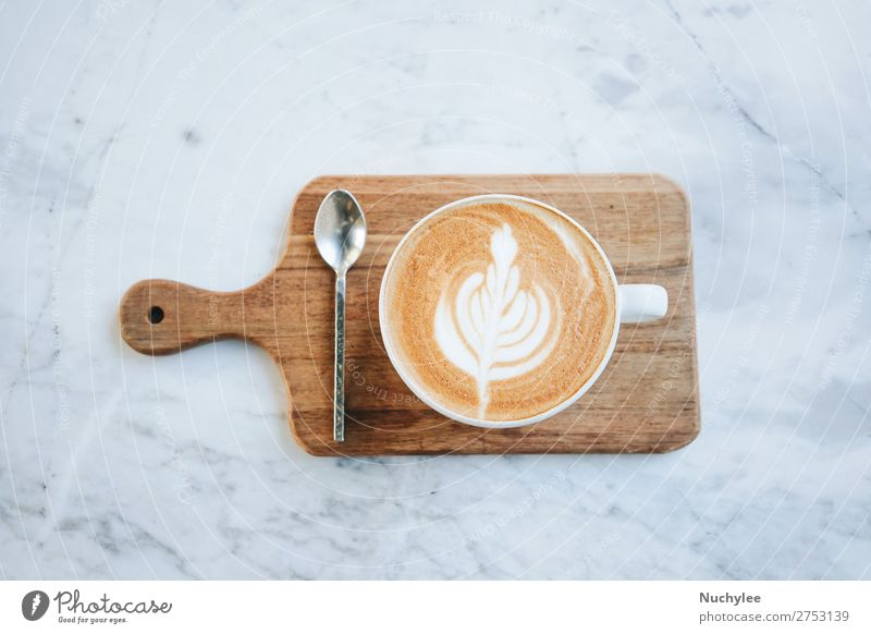 Top view of hot latte coffee on wooden tray Breakfast Coffee Espresso Spoon Table Art Wood Hot Brown Black White Aromatic background Café Cafeteria Caffeine