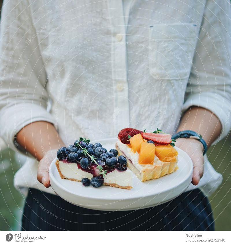 Close up woman hands holding plate of pie Cheese Fruit Dessert Plate Summer Restaurant Woman Adults Hand Fresh Delicious White background Bakery Blueberry Café