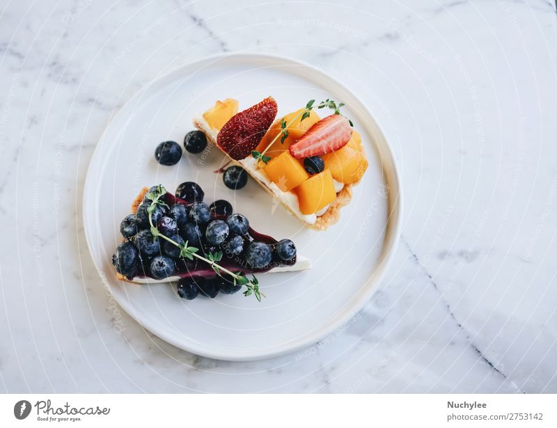 Tasty blueberry pie and mango with strawberry tart Fruit Dessert Nutrition Breakfast Plate Table Fresh Delicious White Tradition Pie background Baking Bakery