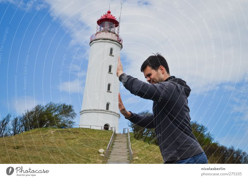 Hiddensee | Italy of the North Island Young man Youth (Young adults) 1 Human being 18 - 30 years Adults Sky Clouds Hill Tower Lighthouse Manmade structures