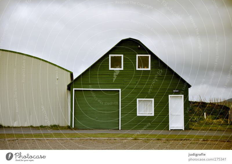 Iceland Clouds House (Residential Structure) Detached house Hut Building Wall (barrier) Wall (building) Facade Window Wood Uniqueness Cold Green