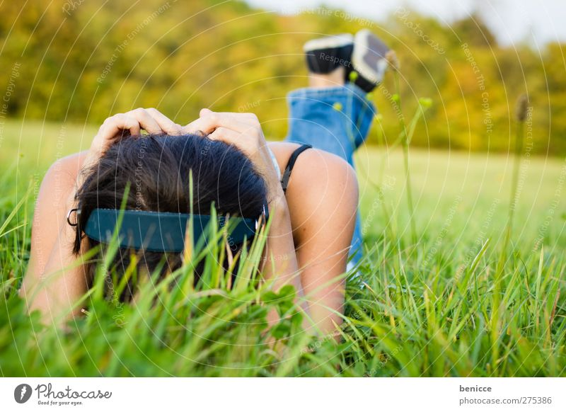 Meadow and music Woman Human being Grass Lie Headphones Music Sound Frustration Contentment Relaxation Summer Spring Loneliness Sadness Grief Hide Feminine