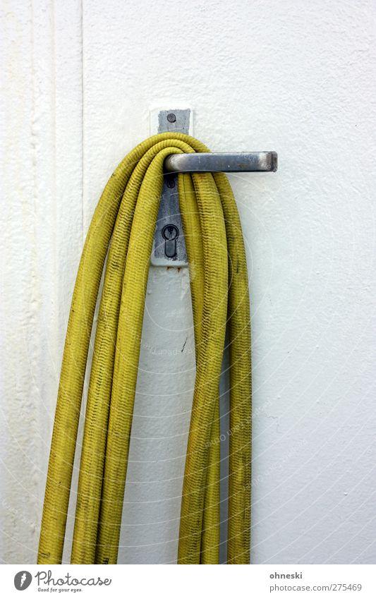 hang out Deserted Door Hose Garden hose Lock Door handle Hang Yellow White Arrangement Colour photo Exterior shot Copy Space top