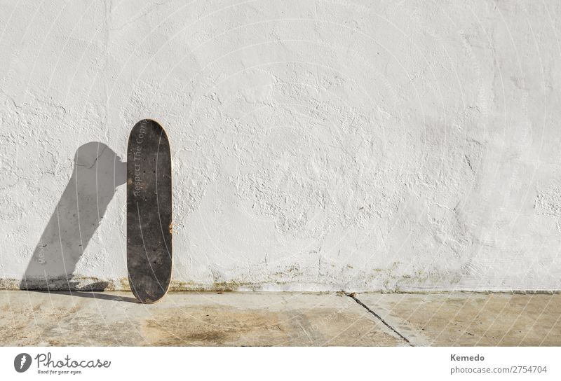 Skateboard on deteriorated white wall during a sunny day. Child Youth (Young adults) Old Summer Town White Relaxation Calm Joy Healthy Street Lifestyle Warmth
