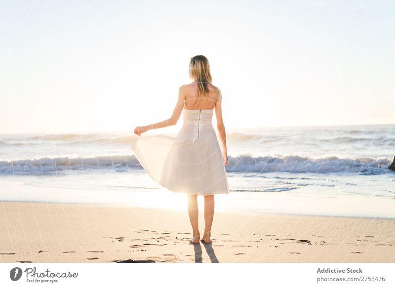 Wonderful tender bride in sunlight Woman Bride Happiness Beach Portrait photograph Cheerful seaside Dress in love seascape Blonde Engagement Sun Expression