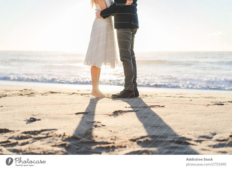 Crop bride and groom on sand Couple Groom Bride Sand Beach Stand Feet in love newlyweds Nature Coast Sunlight Relationship Beauty Photography Barefoot