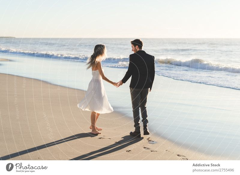 Tender kissing bridal couple in sunlight Couple Wedding Beach Sunlight Engagement Contentment valentine enjoyment in love seascape Stand Relationship Summer
