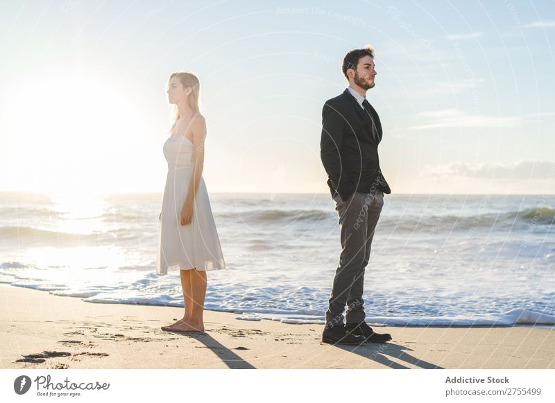 Bridal couple posing on sunny beach Couple Bride Groom Beach dreamers romantic back to back in love Youth (Young adults) Posture Love Together Happiness Style