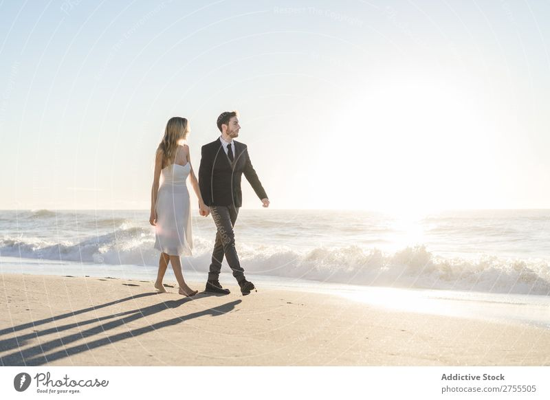 Romantic bride and groom strolling on beach Couple Bride Groom To go for a walk in love Beach romantic Relationship holding hands Dream Youth (Young adults)