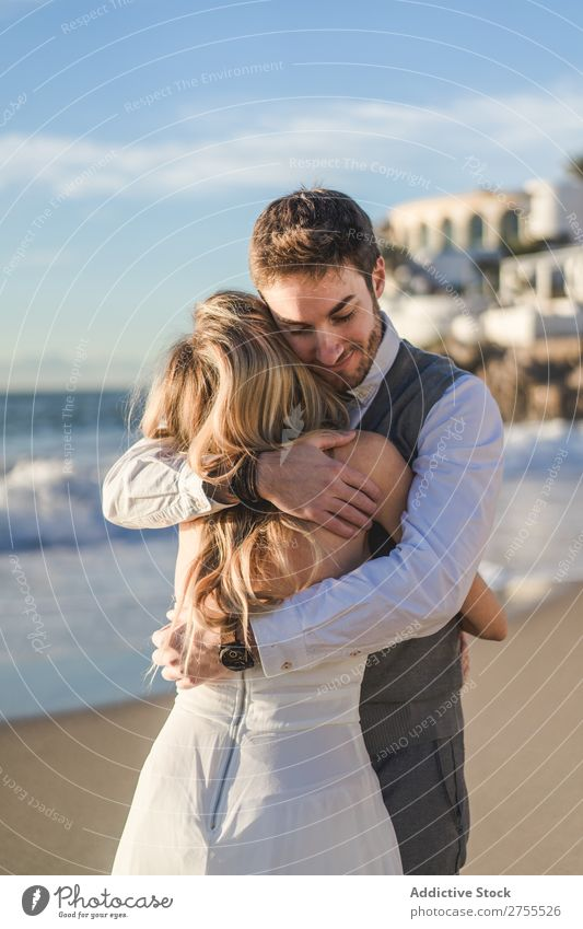 Man embracing bride in sunlight Couple Wedding Embrace tender Back in love Self-confident Engagement Sun romantic Love Bride Groom Dress Emotions Bright Idyll