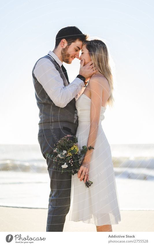 Bride with bouquet embracing groom Couple bridal Embrace Bouquet Feasts & Celebrations Wedding Nature romantic Beach Traveling Love Rustic Flower Together