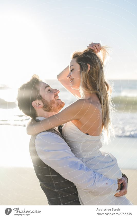Wonderful bridal couple kissing on beach Couple Kissing Beach Wedding Carrying in love To enjoy amorous embracing Love seaside romantic Together Bride Groom