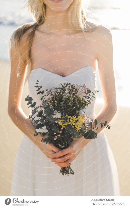 Charming young bride with flowers on beach Woman Bride Bouquet Beach Happiness Portrait photograph Cheerful Dress