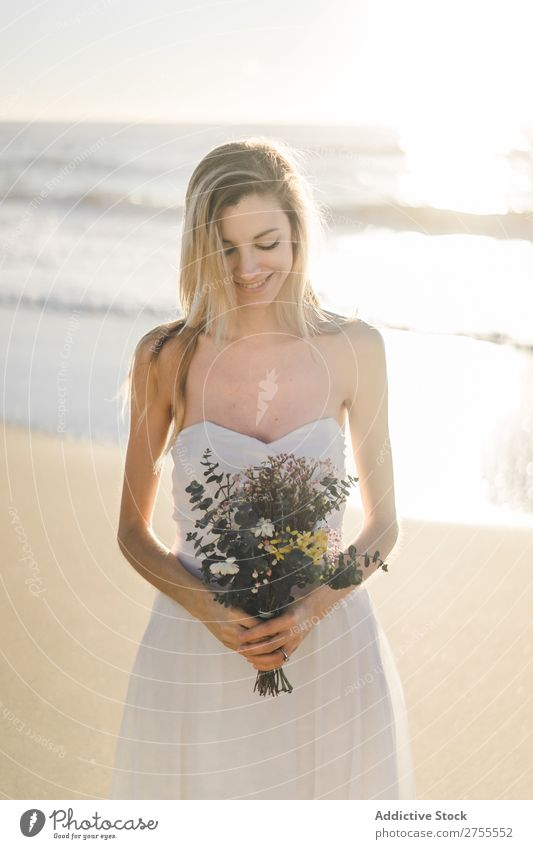 Charming young bride with flowers on beach Woman Bride Bouquet Beach Happiness Portrait photograph Cheerful human face Dress in love Love Elegant Engagement