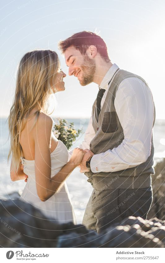 Sensual wedding couple kissing on shoreline Couple bridal Kissing Beach tender in love Wedding Expression romantic Feasts & Celebrations eyes closed Style