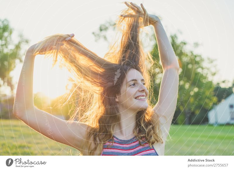 Girl posing in sunlight playing with hair Woman Playful Park Hair Posture Freedom Summer Playing Youth (Young adults) Joy Nature Happiness Beauty Photography
