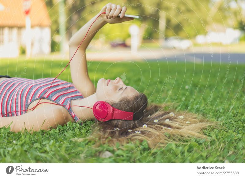 Girl with gadgets on lawn Woman Headphones Relaxation PDA Feminine Music Dream Flower Meadow Entertainment Student Park Summer Freedom Contentment Nature