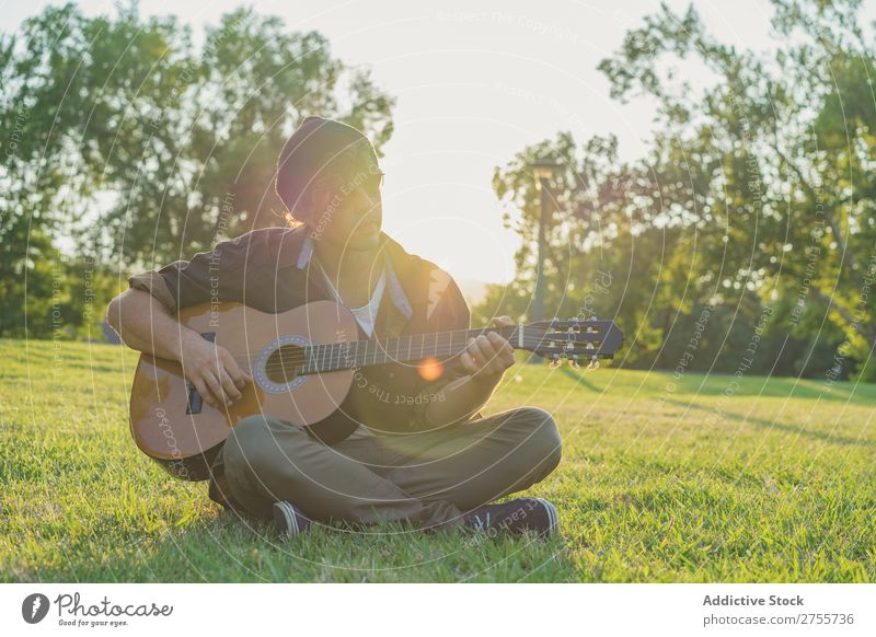 Man playing guitar on nature Park Guitar Summer Playing Landscape Hipster Musician Dream Nature Lifestyle romantic Vacation & Travel singing Easygoing