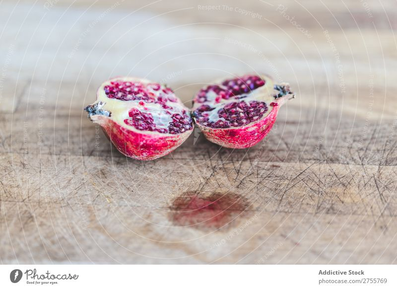 Fresh pomegranate halves on wood composition Pomegranate Rustic Healthy Sweet Fruit Vegetarian diet minimalist Diet Organic Shabby Tasty Juicy Wood Colour Red