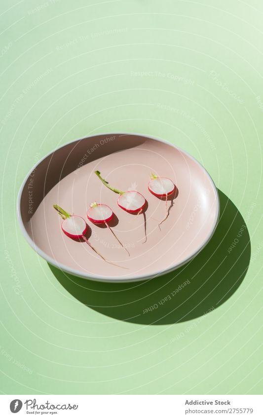 Minimalist composition of radish slices Radish minimalist plates Fresh Organic Nutrition Arrangement Salad geometric Healthy Green Snack Porcelain Diet