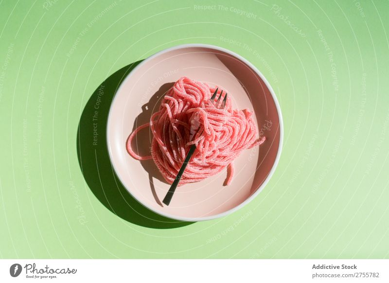 Jelly worms on plate Worms Pink Conceptual design Pasta marmalade Sweet Idea Plate Arrangement Fork served Tasty Candy Bright Meal Eating minimalist conceptual