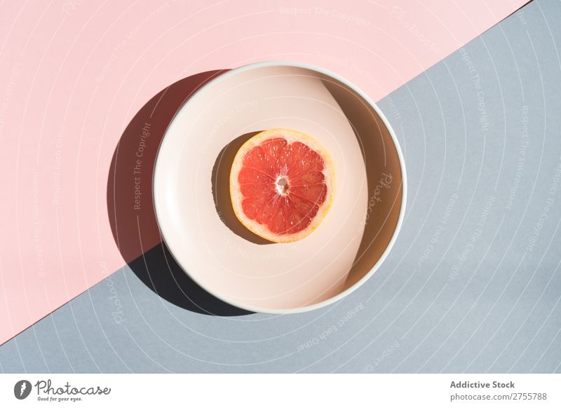 Grapefruit half on round plate Arrangement Plate Colour Studio shot Symmetry geometric Slice Exotic Sweet composition Healthy minimalist Fresh Dessert Bright