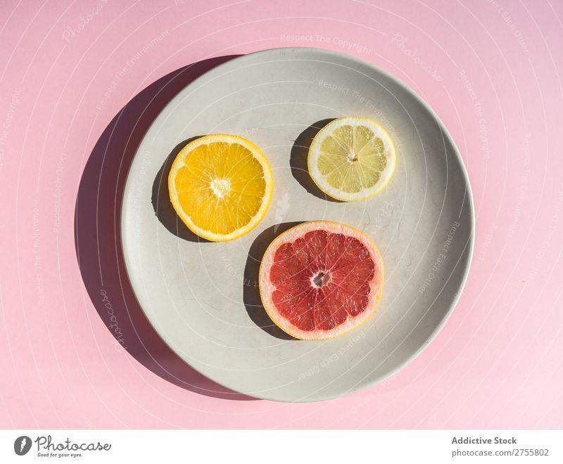 Slices of citrus on round plate Plate slices assortment Fresh minimalist Healthy Juicy Mix Grapefruit Lemon Natural dieting Orange Fruit Pink Delicious Diet