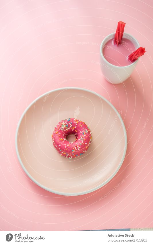 Sweet pink doughnut and sweet pink drink with jelly candies Drinking Jelly Pink Cup Mug Confectionary Milkshake White flavored Studio shot Sugar Dessert garnish