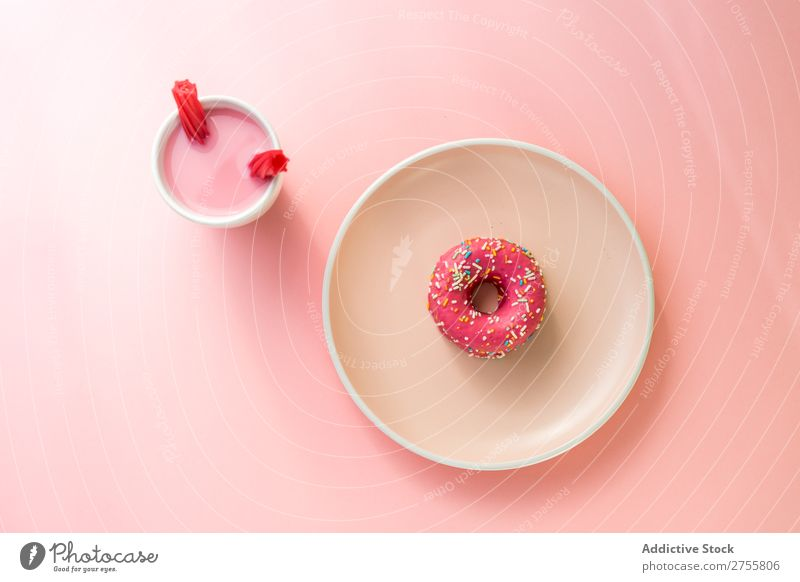 Sweet pink doughnut and sweet pink drink with jelly candies Drinking Jelly Pink Cup Mug Confectionary Milkshake White flavored Studio shot Sugar Dessert