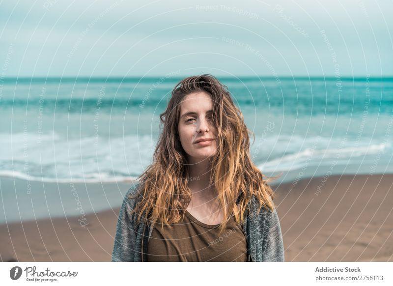 Woman posing on blue ocean Ocean Posture Tourism Portrait photograph Vacation & Travel Paradise human face Easygoing tropic Adventure Tourist Style Lagoon