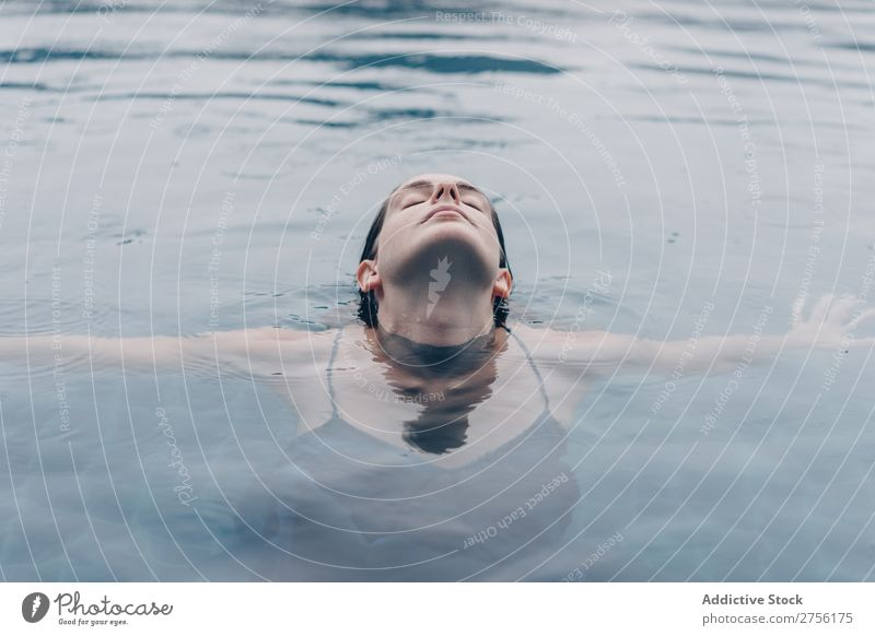 Woman with closed eyes in water Lie (Untruth) Swimming Face upside down Swimming pool Water Human being Summer Blue Vacation & Travel Resort Action Relaxation